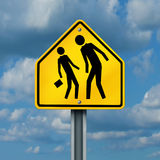 School Bullying. Concept as a yellow traffic sign with an abusive bully attacking or harassing a smaller defenseless student as a symbol of the anxiety of being Royalty Free Stock Photos