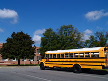 School Bus. Waiting at the School to Pick Up Kids from School Stock Image