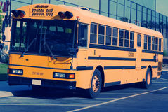 School Bus. American School Bus witing to pick up students Royalty Free Stock Photo
