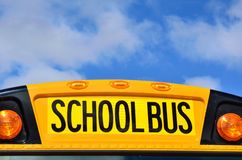 School Bus. Yellow School Bus with Blue Sky and Clouds Royalty Free Stock Photography