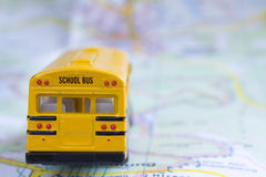 School bus. Yellow school bus on a city map view from the back stock images