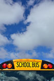 School Bus. Yellow School Bus with Blue Sky and Clouds royalty free stock images