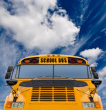 School bus. Yellow school bus against deep blue sky with clouds Royalty Free Stock Photography