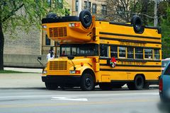 School Bus. Yellow school bus stops to pick up passengers Stock Photos