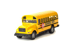 School Bus. A toy school bus shot on a white background with a shadow underneath Stock Image