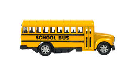 School Bus. Side view of a toy school bus with the door, isolated against a white background Stock Photography