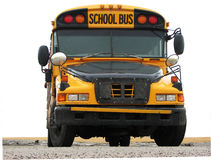 School Bus. A picture of a face first school bus on pavement with a white background Stock Images