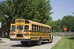 School Bus. On it's route taking children home in the afternoon royalty free stock images
