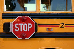 School Bus. Side of school bus with stop sign stock photography
