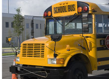 School Bus. Parked outside a school after dropping children off Royalty Free Stock Images
