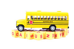 School bus and alphabets stock photos