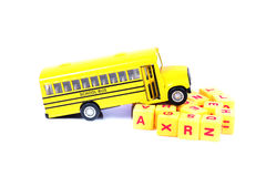 School bus and alphabets Stock Photography