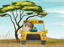 A school bus and boy Royalty Free Stock Photos
