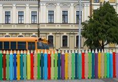 School bus, building, colofrul pencils wall. Royalty Free Stock Images