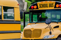 School Bus / Buses in the city Stock Image