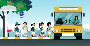 School bus. Es pick up students at the bus stop Stock Image