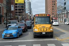 School bus. Chicago, Usa - march 16, 2018: School bus stopped at the sign of a crossing in the city of Chicago Royalty Free Stock Photography