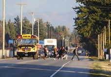 School Bus and Children. Children cross a busy street after leaving a school bus Stock Photos