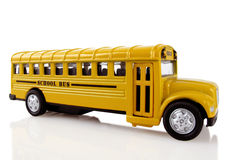 School Bus is Coming. Bright yellow school bus arrives to transport children Stock Images