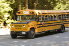 School Bus on Country Road Stock Photography