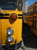 School bus detail. Details of school bus with headlight and orange  turn signal Stock Image