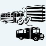 School bus driving along street Royalty Free Stock Image
