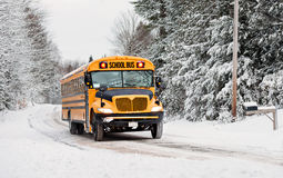 School Bus Driving Down A Snow Covered Rural Road - 3 Royalty Free Stock Image
