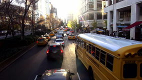 School Bus driving through Manhattan USA cityscapes stock footage
