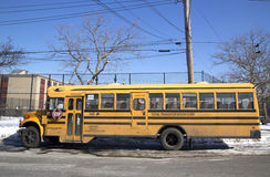 School bus in the front of public school in Brooklyn Stock Images