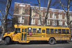 School bus in the front of public school in Brooklyn Royalty Free Stock Photo