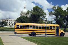 School Bus in front of State Capitol Royalty Free Stock Image