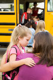 School Bus: Girl Doesn't Want To Go To School Royalty Free Stock Photography