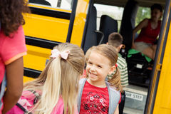 School Bus: Girls Talking In Line For Bus Stock Image