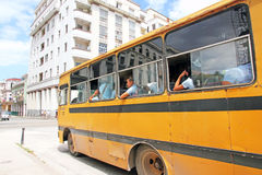School Bus In Havana. Old school bus with students in a street in Havana,Cuba Royalty Free Stock Photos