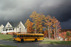 School bus and homes Stock Photography