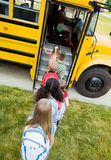 School Bus: Kids Getting On Bus. Series with elementary aged students and a school bus Stock Images