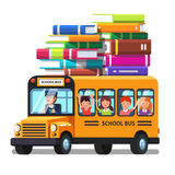 School bus with kids and lots of books luggage Royalty Free Stock Photos