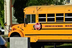 Classic yellow american school bus transporting children to the school. stock photos