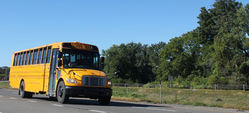 School Bus. A school bus on a major highway stock photos