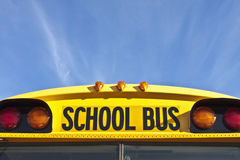School Bus Markings and Signal Lights. Front of yellow school bus above windshield, showing school bus identification marking, flasher and clearance lights with Stock Image