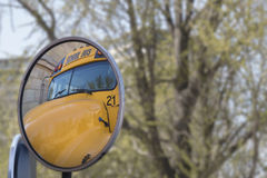School bus in the mirror Royalty Free Stock Photo