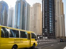School bus in motion in Dubai, UAE. Blurred School bus is driving on a street in Dubai, UAE Stock Images
