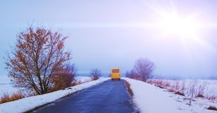 The school bus moves along the highway in winter_ stock images