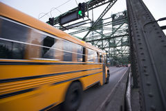 School bus is moving on bridge with green traffic light Stock Images