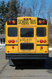 School bus in the neighborhood. Showing the back Royalty Free Stock Photo