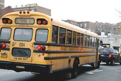School bus in New York City street. In a cloudy day in NYC Stock Photos