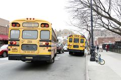School bus in New York City street. In a cloudy day in NYC Royalty Free Stock Image