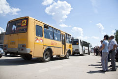 School bus. Parents look at the school bus with children in Russia Stock Photos