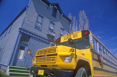 A school bus parked in front of an old building, Port Wing, Wisconsin Royalty Free Stock Image