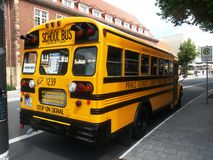 School bus in germany. School bus parked in a german city , looks like in a classic film about school Stock Images